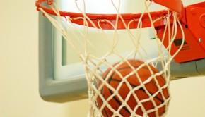 Basketball goes through hoop.