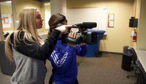 Two students taking videos with a Sony camera