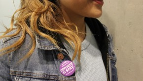 """Close up shot of a girl wearing a """"Consent is Sexy"""" pin in support of the month"""
