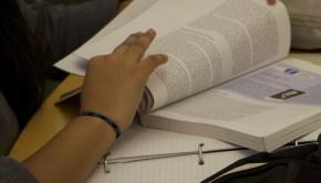 Student analyzing book