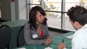 An interviewer meets with a job candidate