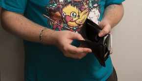 student holding empty wallet