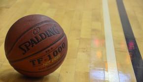 A photo of a basketball on a gym floor