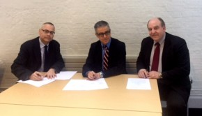 Representatives of Guelph-Humber and City Law School signing the agreement