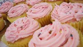 Yellow cake cupcakes with pink sprinkle frosting